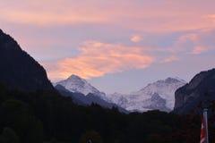 Picco di Snowy della montagna di Jungfrau al tramonto Immagini Stock Libere da Diritti