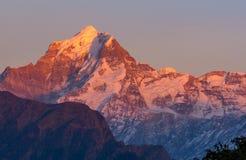Picco placcato della neve in Himalaya Fotografia Stock