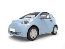 Piccola automobile elettrica moderna urbana blu pastello Immagine Stock Libera da Diritti