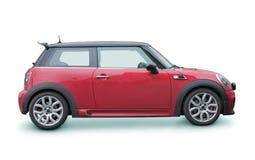 Piccola automobile rossa Immagini Stock