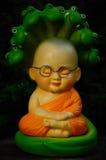 Piccola bambola del monaco con il serpente Fotografia Stock Libera da Diritti