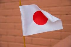 Piccola bandiera del giapponese Immagine Stock