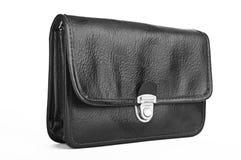 Piccola borsa personale nera isolata su bianco Immagini Stock
