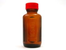 Piccola bottiglia del veleno con la protezione rossa fotografia stock libera da diritti