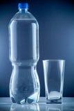 Piccola bottiglia di acqua Fotografie Stock
