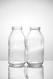 Piccola bottiglia di vetro due Fotografia Stock Libera da Diritti