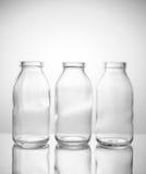 Piccola bottiglia di vetro tre Fotografia Stock