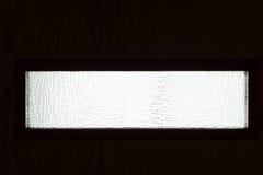 Piccola finestra di visualizzazione sulla porta Immagini Stock