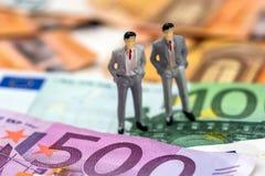 Piccola gente nell'euro fotografia stock libera da diritti