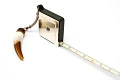 Piccola misura di nastro metallica come pendente immagini stock