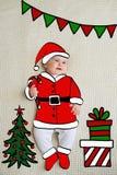 Piccola neonata schizzata come Santa immagine stock