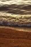 Piccola onda di ribollimento al tramonto Immagine Stock Libera da Diritti