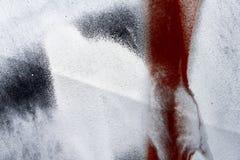 Piccola parte della superficie di metallo graffiata dipinta con il nero, bianco Fotografia Stock Libera da Diritti