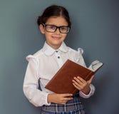 Piccola ragazza affascinante della scuola Fotografie Stock Libere da Diritti