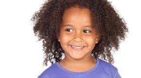 Piccola ragazza africana con una bella espressione fotografia stock