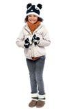 Piccola ragazza alla moda in vestiti caldi Fotografie Stock