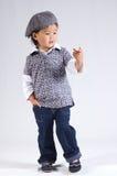 Piccola ragazza asiatica con un cappello immagine stock libera da diritti