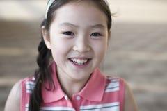 Piccola ragazza asiatica sorridente Fotografie Stock