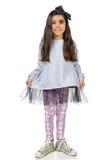 Piccola ragazza castana nella posa alla moda del vestito Fotografie Stock