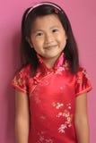 Piccola ragazza cinese con il vestito rosso Fotografia Stock