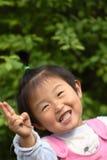 Piccola ragazza cinese sveglia fotografia stock