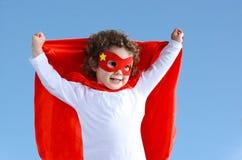 Piccola ragazza del bambino del supereroe Immagine Stock