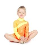 Piccola ragazza della ginnasta su fondo bianco Fotografie Stock