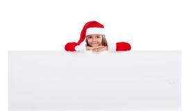 Piccola ragazza di Santa con la grande insegna Fotografie Stock Libere da Diritti