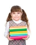 Piccola ragazza felice con i libri del mucchio Isolato su priorità bassa bianca Fotografie Stock Libere da Diritti