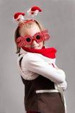 Piccola ragazza felice del bambino di Natale con i vetri 2015 Immagini Stock Libere da Diritti