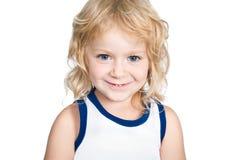 Piccola ragazza sorridente isolata su bianco Fotografia Stock
