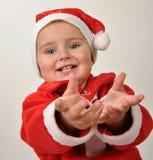 Piccola ragazza sorridente sveglia del bambino della Santa Fotografie Stock
