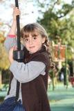 Piccola ragazza su una rotonda fotografie stock libere da diritti