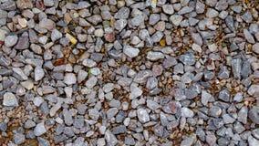 Piccola roccia decorata come modo al suolo Fotografie Stock
