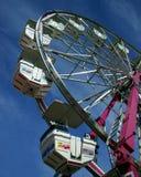 Piccola rotella di Ferris ad una fiera Fotografie Stock Libere da Diritti