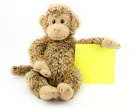 Piccola scimmia con il blocco note Fotografie Stock