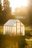 Piccola serra e luce dorata dell'alba Fotografie Stock