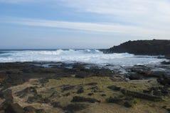 Piccola spiaggia di sabbia verde Hawai Immagini Stock