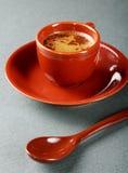 Piccola tazza di caffè con un cucchiaio Fotografie Stock