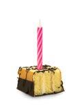 Piccola torta con la candela immagini stock