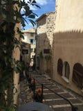 Piccola vecchia via della città Immagine Stock