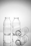 Piccola versione 2 della bottiglia di vetro tre Immagini Stock