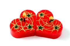 Piccole candele rosse del cuore. Isolato su bianco immagine stock libera da diritti