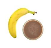 Piccole e grandi banane su un fondo bianco Fotografia Stock Libera da Diritti