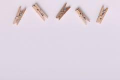Piccole mollette di legno sveglie Fotografia Stock Libera da Diritti