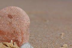 Piccole pietre sulla spiaggia Fotografia Stock