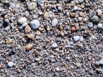 Piccole pietre sulla spiaggia Fotografie Stock