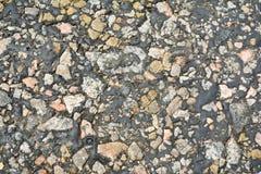 Piccole pietre, vecchio bitume, il passo fuso, una foto del vecchio immagini stock