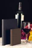 Piccoli album con il vetro di vino Fotografia Stock Libera da Diritti