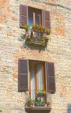 Piccoli balconi di un palazzo vecchio Royalty Free Stock Photos